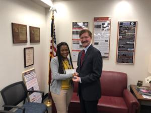 Felicia Grizzle receiving her Good Catch award for her great work at NNSA