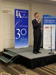 John Longenecker offering a toast to L&A's 30th Anniversary at the 2019 National Cleanup Workshop