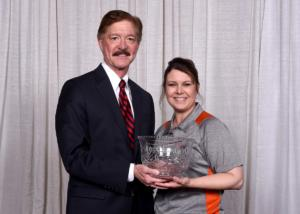 John Longenecker presenting WMS' Melanie Ravalin with the L&A Management Excellence Award